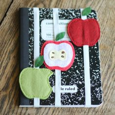 Felt Apple Notebook Hugger--I want to make the one with the bite out of it.  too cute.