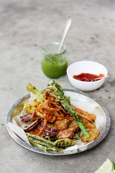 """These Pakoras with Fresh Green Chutney almost look too pretty to eat. Emphasis on """"almost."""""""