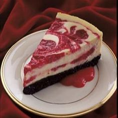 "Cherry Swirled Cheesecake : Combine 1.25c Oreo baking crumbs, 1/4c sugar, 1/3c butter -melted. Press into bottom of 9"" springform pan. Puree 21oz can cherry pie filling til smooth. Beat 2 8oz pkgs cream cheese til fluffy. Gradually beat in 14oz sw.cond. milk. Beat in 3eggs, one at a time, then 1/3c lemon juice, 1tsp vanilla. Pour half of batter onto crust; top with 1/2c. of puree. Repeat both. Swirl with knife. Bake 300deg 50-55min til center set. Cool; chill. Serve with remaining puree."