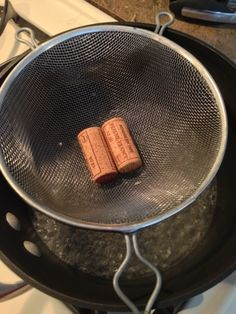 "Cut Corks Easily: 1.Fill a saucepan with ~2"" of water. 2. Add strainer/sifter to pan. Make sure the water does not touch the strainer/sifter. 3. Add corks to shifter. Cover. Boil water for 3-5 minutes. Corks will slice very thinly without crumbling."
