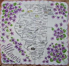 Illinois state map + purple violets [handkerchief / scarf].  When I was about ten years old I started a collection of state handkerchiefs and had quite a few.  Somewhere between household moves they became misplaced.  This is my new collection .