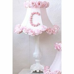 "Roses Personalized Table Lamp by Ababy. $289.00. Recommended Wattage: 40/60. 18""H to top of shade - Shade: 11.5""W at bottom, 9""H. Lovely LightOur Roses Personalized Table Lamp adds the perfect finishing touch to your room. Set upon an beautiful ornate base, the bell shaped, scalloped lamp shade is made of a luxurious silk dupioni. The upper-case initial of your choice is crafted from mini pink mulberry roses and the shade is trimmed with matching large roses. Truly magn..."