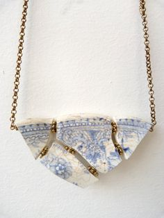 Blue and white porcelain shards mosiac necklace with gold plated belcher chain, adjustable length.