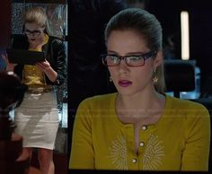 Felicity's yellow beaded cardigan and white side-zip skirt on Arrow.  Outfit Details: http://wornontv.net/27663/ #Arrow