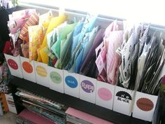 Use magazine holders to group paper scraps by color. | Community Post: 45 Organization Hacks To Transform Your Craft Room