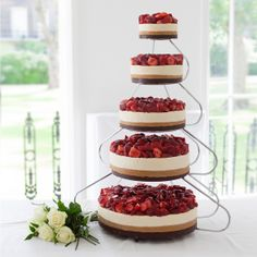 We want this amazing cheesecake wedding cake every day of our lives! 5 Tier Strawberries & Queen Wedding Cheesecake