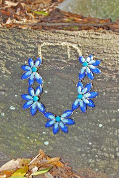 Statement necklace in a jeweled flower design. Each flower is about 2″ wide. 9″ necklace with 2″ extender. fd7ab7a4e02db07a8d609d3a9d494639
