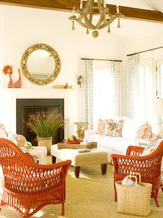 Nantucket cottage by the sea. Orange wicker chairs.
