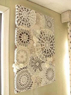 Great way to display old doilies. Black canvas use liquid starch or mod podge to make them stick