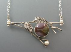 Branch necklace with leaves, freshwater pearls and a stunning agate stone handcrafted by Kryzia Kreations as a one-of-a-kind design  http://www.kryziakreationsstudio.com/products/tree-branch-necklace-with-agate  $310.00