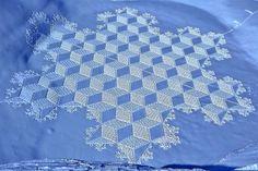 Artist Simon Beck walks countless miles to create massive snow patterns.