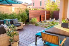 contemporary backyard landscape ideas - low decking