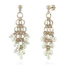These chandelier earrings present cascading links and faux pearls interlaced with an edgy elegance. Made of bronze-tone brass. Set with round white faux pearl. Earrings measure 2.5 inch in length, 1 inch in width. Posts with butterfly backs.