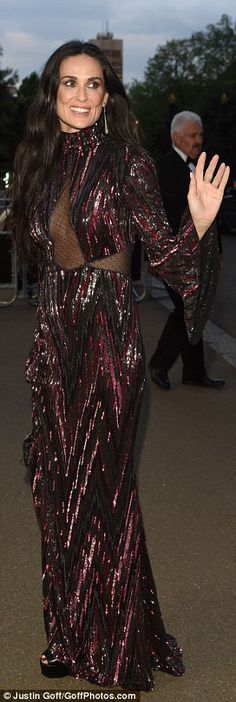 Gimme Moore! Demi Moore provided some Hollywood glamour in a red and black sequinned dress...