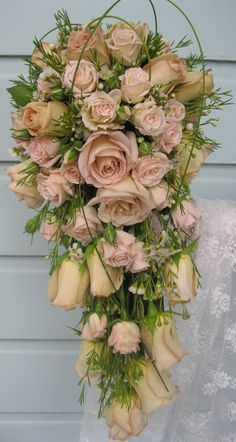 """""""Honeymoon""""  roses with pink spray roses in a trailing bouquet, Geraldton wax touches!"""