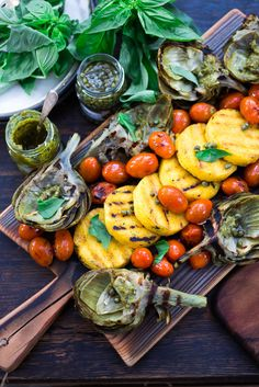 Grilled Artichokes and Polenta with Blistered tomatoes, pesto, capers and fresh basil-- served family style ...perfect for a casual summer evening! Vegan and GF