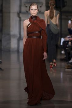 Yiqing Yin Spring 2016 Couture Fashion Show  Feels like a costumey monk look of sorts, wouldn't be at all out of place in GOT  http://www.vogue.com/fashion-shows/spring-2016-couture/yiqing-yin/slideshow/collection#6  http://www.theclosetfeminist.ca/