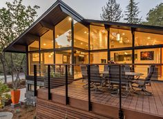 Mid-Century Modern exterior. Wall of windows. Stained wood deck with cable railing. - Houzz.com