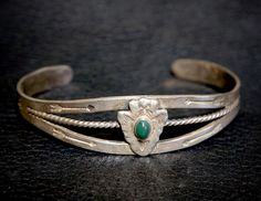 """Fred Harvey Era Native American Arrowhead Silver & Turquoise Bracelet with Thunderbirds at the ends. There is a stamped marking shown in pictures. Measures 6 3/4"""" around the inside including the gap. Gap is 1 1/4"""" and is adjustable. Measures 3/4"""" tall. Weight 15.4 grams.$105.00 by FarRiderWest on Etsy"""