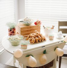 Buffet table at child's peach-themed first birthday
