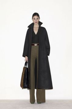 sleek and sophisticated by Celine -  I'd like to see this with a lighter scarf that would draw color up to Melania's eyes and face.