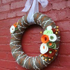 Easy yarn felt wreath tutorial. Video included to show how to make felt flowers.