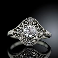 Exquisite Edwardian diamond ring from the archives of Lang Antiques Edwardian and Art deco are my faves, anything with filagree and halos LOVE LOVE LOVE IT!