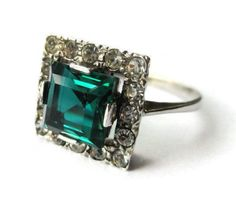 SOLD. Art Deco emerald paste and faux diamond ring, vintage square green + clear crystal, silver plated, diamante rhinestone, 1930s Jazz Age. https://www.etsy.com/uk/listing/501405798/art-deco-emerald-paste-and-faux-diamond