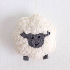Little Sheep Christmas Ornament, Lamb Ornament, Sheep Plush, Handmade Ornaments, Christmas Ornaments, Sheep Nursery Decor by LittleCelandine on Etsy https://www.etsy.com/listing/399453061/little-sheep-christmas-ornament-lamb