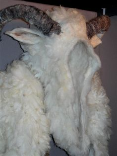 Felted or felt horns and hide?  amazing!
