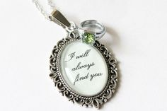 I will always find you necklace with green rhinestone ring charm (OUAT). $14.00, via Etsy.