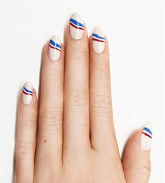 Wavy red, white, and blue striped manicure by Jin Soon