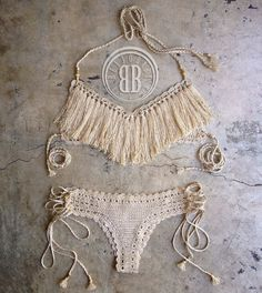 Classic and timeless. This fringe bikini is hand crafted in quality threads with complete attention to details.  Limited edition design.  We will send