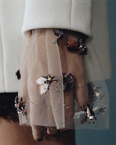 Beetle/bug brooches on a sheer sleeve
