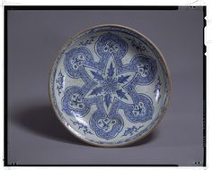"Plate  Vietnam, Lê dynasty (15th – 16th century)  Chrysanthemum flower within ""Sasanian star"" painted in underglaze-cobalt, chocolate base  D. 36,20 cm  Tokyo, National Museum, TG-2234"