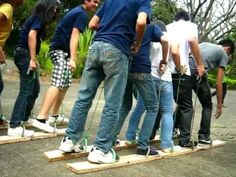 Bel facilitating a team building event (plank walk) for Cavite Institute students