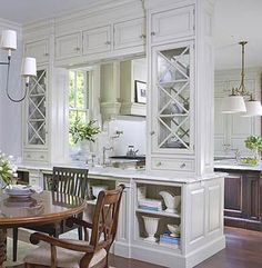 Cabinets with lots of storage and beautiful glass see through door for a kitchen pass-through to the dining area.