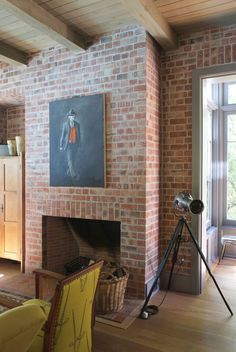Karen & Gawie's Artistic Home in South Africa Two Story Fireplace, Brick Fireplace Wall, Viking Stove, Orange Lamps, Anglepoise Lamp, Exposed Brick Walls, Two Story Homes, House Drawing, Dining Nook