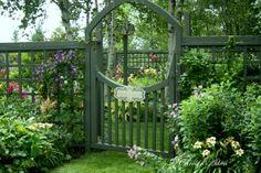 Beautiful garden gate and garden.