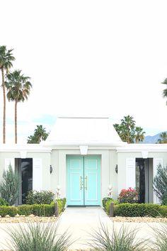 Door Goals: Beautiful aqua blue Hollywood Regency door in Palm Springs