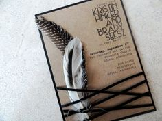 wedding invitation with feathers.