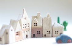 Small clay houses.  Shelf village of 6 ceramic buildings. Housewarming present. Pottery houses. Fiona Findlay UK. Ceramic houses