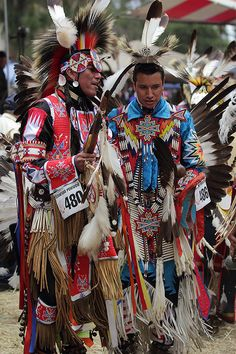 Northern Traditional dancers.  Don't know man in red but man in blue is Ardell Scaloplock (minus face paint)