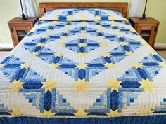 Blue and Yellow Colorado Log Cabin -- Timeless colors of blue and soft yellow are sure to brighten any bedroom! A cheerful design that is rarely available. Nicely made with lovely hand quilting. Made in Lancaster County, Pennsylvania by an Amish woman. A popular design by Judy Martin. For more photos and purchasing information see https://www.amishcountrylanes.com/Pages/hs6813.shtml?InStock