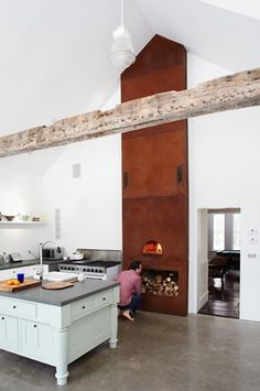 """Eldred farmhouse rental - An enormous kitchen features a wood burning pizza oven and 48"""" commercial stove."""