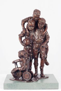 Bronze Sculpture of Children by artist Graham Ibbeson titled: 'Interrupted Celebration (bronze Group of Children Footballers)'