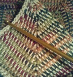 Two-color Tunisian crochet mitered corner squares by fugitive247