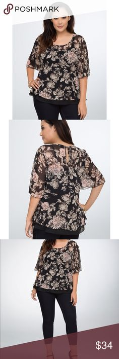 """Torrid Floral Peplum Blouse This vintage-inspired floral print top has us feeling the love. Black chiffon is covered in a dusty pink flower print, while flowy sleeves and a peplum cut keep you floating. Sheer on top, with a black slip underlay that peeks out for a cool contrast. made of 100% polyester. Torrid size 00.  Front length 26""""/ back length 28"""". torrid Tops"""