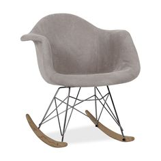 Inspiré par la Chaise à bascule RAR de Charles & Ray Eames.     La structure des jambes est basé sur la Tour Eiffel.     Pieds concaves enhêtre.     Modèle tapissé en tissu gris.     Design polyvalent, combines facilement avec différents styles.  Un des modèles les plus populaires en ce qui concerne le design d´avant garde du dernier siècle est transformé avec une touche de tapisserie gris.La chaise TOWER ARMS TELA combine style, élégance et commodité pour donner une touche différent...