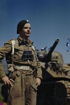 The 'Tankman'. Sergeant A G Williams of 17/21 Lancers standing beside his Sherman tank at the main Headquarters of the Eighth Army in the San Angelo area of Italy. Sergeant Williams from Woodford Bridge, Essex left England in November 1943, landed in North Africa, and from there was sent to Italy.